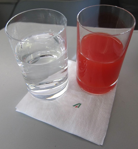 Water and orange juice pre-departure drinks