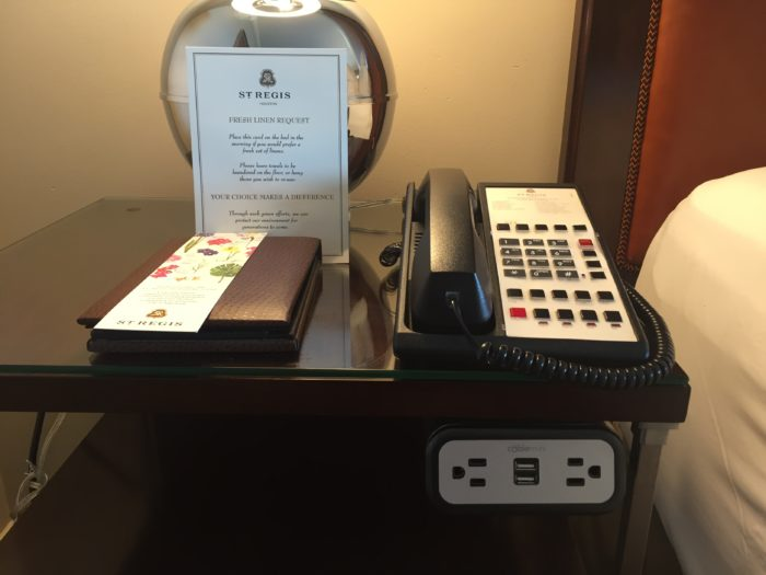 St. Regis Houston Grand Luxe Room bedside desk with charging area