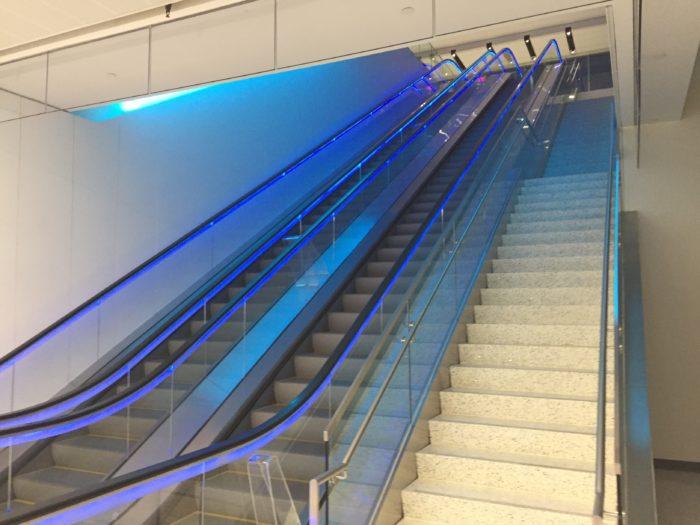 Escalators to main level of United Club LAX